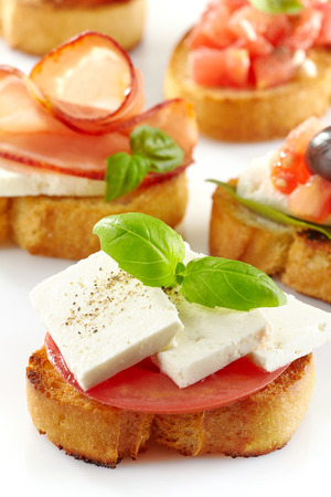 Toasted bread with fresh goat cheese and tomato. Spanish tapas Stock Photo - 28512895