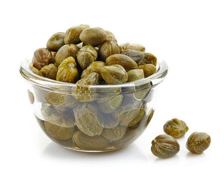bowl of capers on a white background photo