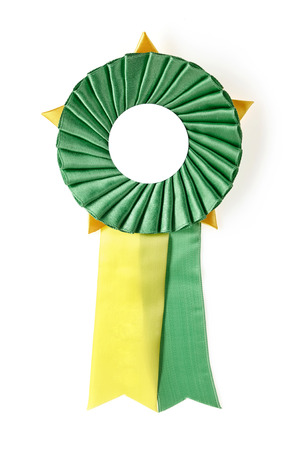 green and yellow award rosette on a white  photo