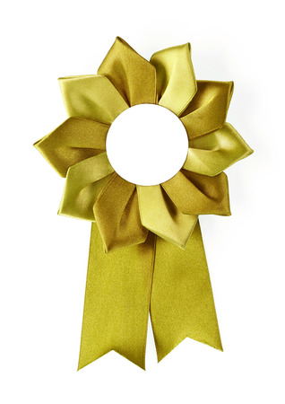 gold award rosette on a white  photo