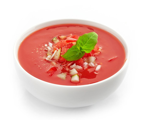 bowl of cold tomato soup gazpacho on a white
