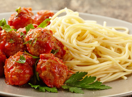 Meatballs with tomato sauce and spaghetti on plate photo