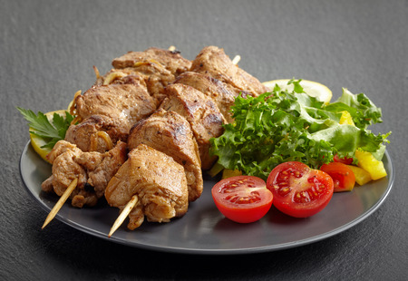 Pork barbecue, grilled pork meat on a plate photo