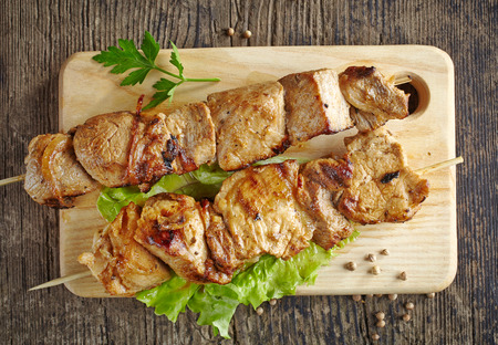grilled pork meat kebab on wooden skewers photo