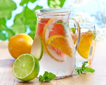 water jug: jug of cold nonalcoholic citrus fruit drink