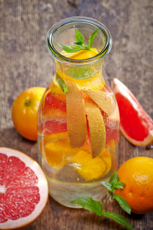 carafe: bottle of cold nonalcoholic citrus fruit drink