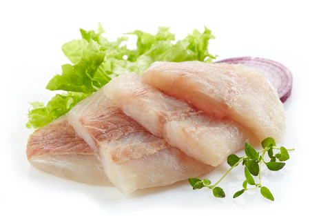 hake: raw hake fish fillet pieces on a white background