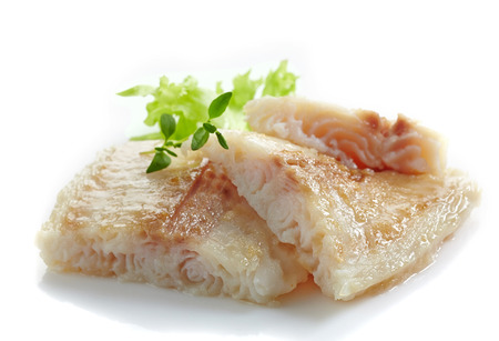 pangasius: fried pangasius fish fillet pieces on a white background Stock Photo