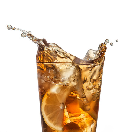 splashing iced tea with lemon on a white background Stock Photo