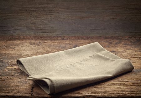 serviette: linen napkin on dark wooden table Stock Photo