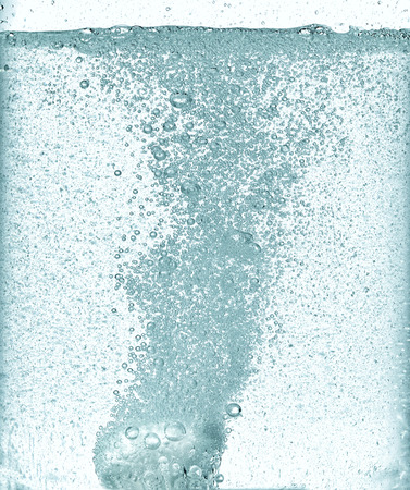 effervescent dissolving fizzy tablet in a water