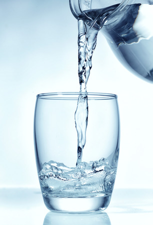 water jug: fresh water pouring into glass  Stock Photo
