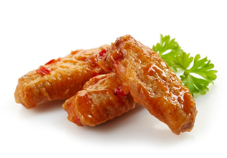 fried chicken wings with sweet chili sauce on white background Standard-Bild