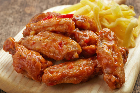 fried chicken wings with sweet chili sauce and french fries, buffalo wings