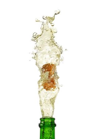 popping cork: splashing champagne on a white background