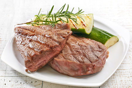 grilled beef steak and vegetables on plate photo