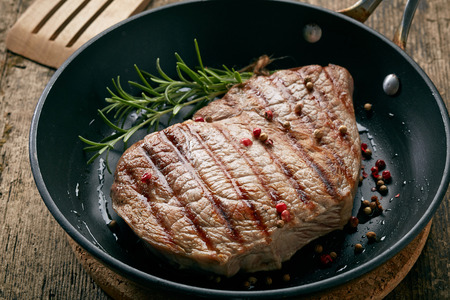 grilled beef steak with rosemary on frying pan Stock Photo