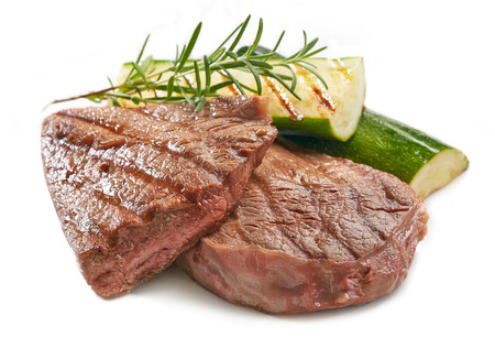 grilled beef steak and vegetables on white background
