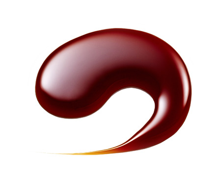 chocolate syrup: chocolate drop macro on a white background Stock Photo