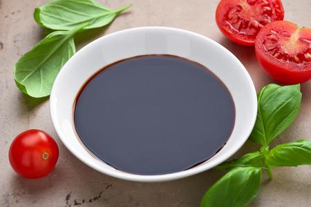 bowl of balsamic vinegar and vegetables Foto de archivo