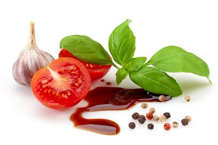 balsamic: tomato, basil and balsamic vinegar on a white background