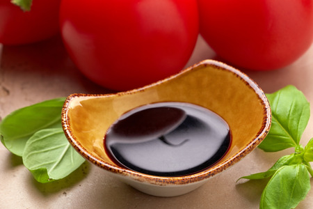 balsamic: Bowl of Balsamic vinegar and basil leaves
