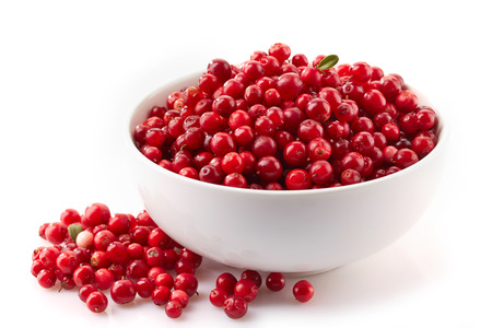 bowl of cowberries on a white background Stock Photo