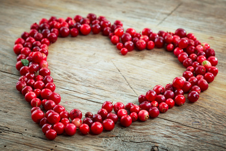 forest symbol: heart shape of fresh cowberries