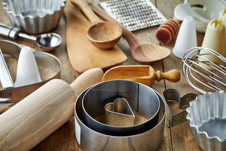 kitchen tools: various kitchen utensils on wooden table