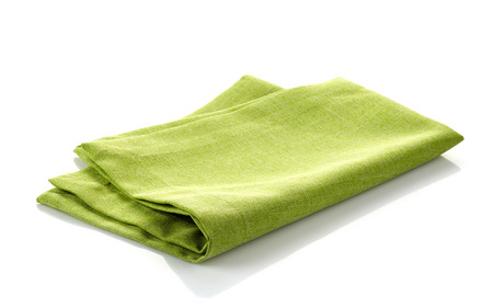 green folded cotton napkin on a white background Banco de Imagens