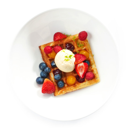 Belgium waffles with ice cream and fresh berries photo