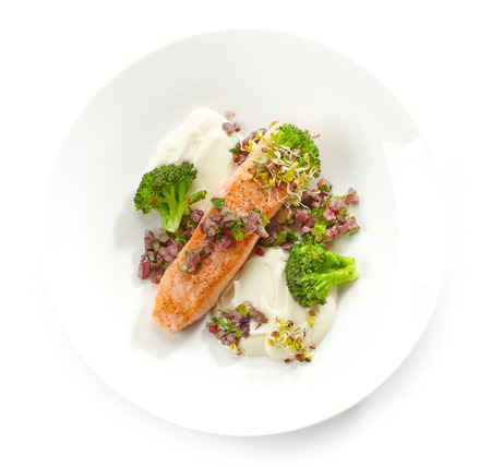 fried foods: grilled salmon fillet with vegetables on a white plate