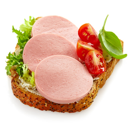 sandwich with sliced sausage on a white background photo