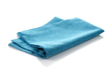 fabric design: blue folded cotton napkin on a white background