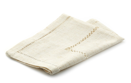 serviette: folded linen napkin on a white background