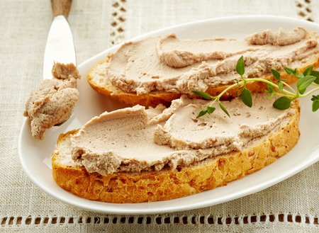 bread slices with liver pate on linen napkin
