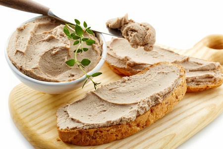 pate: sandwich with liver pate on wooden cutting board