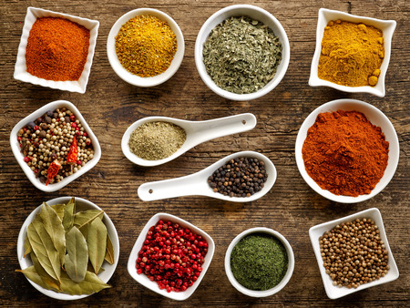 various kinds of spices on wooden table Stockfoto