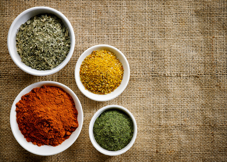 chili powder: various kinds of spices on burlap background