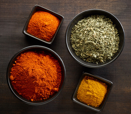 curry powder: various kinds of spices on wooden table Stock Photo