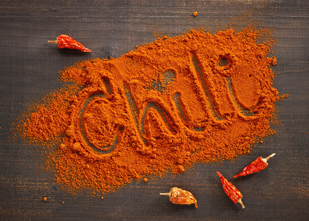 chili powder: ground Chili pepper on wooden table