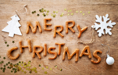 Gingerbread words Merry Christmas on old wooden table