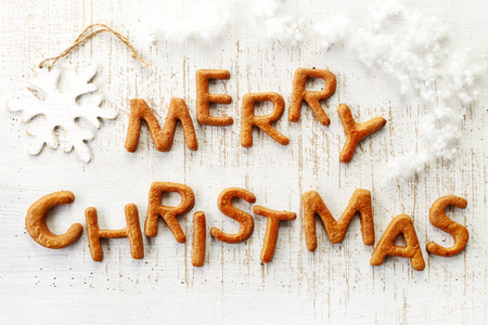 Gingerbread words Merry Christmas on old wooden table photo