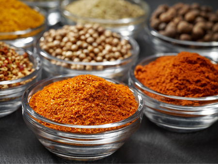 dry stone: various kinds of spices on black stone surface Stock Photo