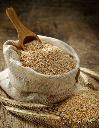 grits: wheat grits sack on old wooden table