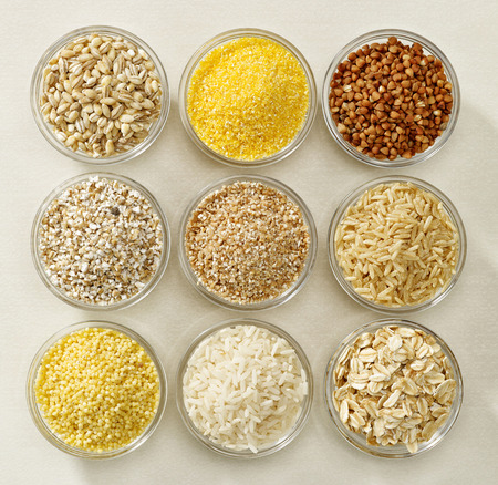 unprocessed: various kinds of cereal grains in glass bowls