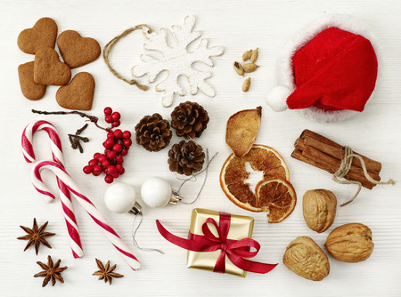 various Christmas decorations on white wooden table photo