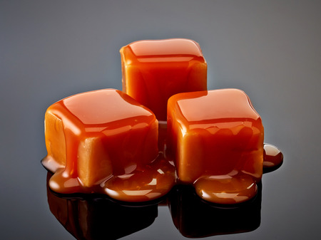 caramel candies on black background