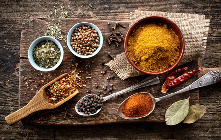 indian food: various spices on old wooden table