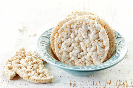 galettes: rice galettes in blue bowl Stock Photo